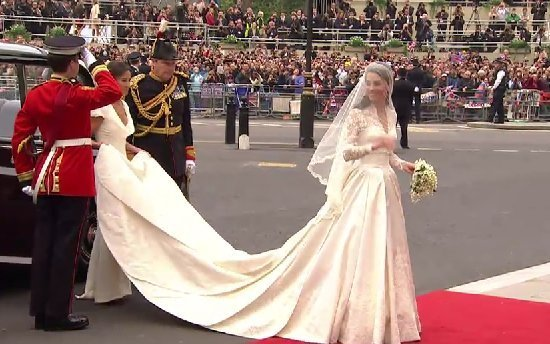 Kate Middleton arrives at Westminster abbey in a wedding dress that is corseted.